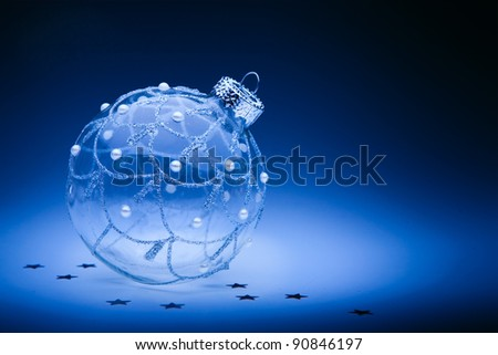 design christmas card with christmas ball on dark blue background