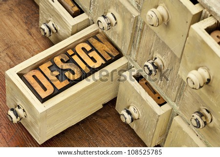 design concept - a word in vintage letterpress wood type and primitive rustic wooden apothecary drawer cabinet