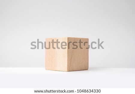 Design concept - abstract geometric real wooden cube with surreal layout on white floor background and it's not 3D render #1048634330