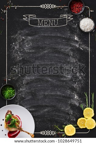 Design concept for restaurant menu mockup. Black rustic chalkboard with white inscription and vegetables frame, top view, copy space for text and logo #1028649751
