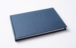 Design concept - Perspective view blue hardcover notebook cover isolated on background for mockup. Not 3D render