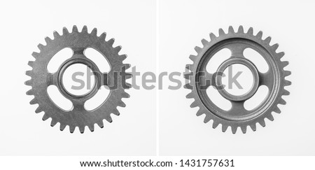 Design concept - top view of metal gear isolated on white background for mockup. real photo, not 3D render
