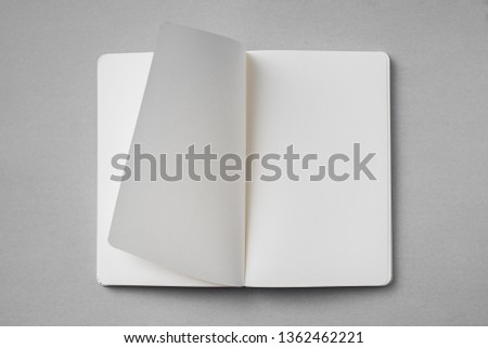 Design concept - top view of white notebook with blank open, turn and flipped page on grey background for mockup. real photo, not 3D render #1362462221