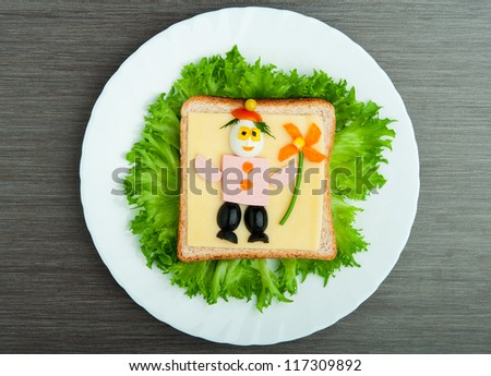 design food. Creative sandwich for a child with a picture little man