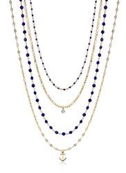 Design gold necklace. It has precious stones on it.