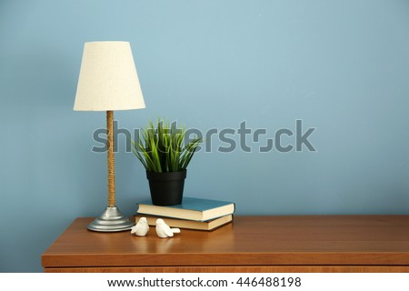 Design interior with lamp and plant on blue wall background