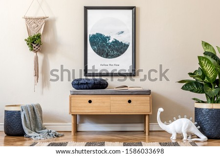 Design scandinavian home interior of living room with wooden commode, design table lamp, macrame, rattan basket with plants and elegant accessories. Stylish home decor. Template. Mock up poster frame.