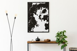 Design scandinavian interior of living room with wooden console, ring on the wall, black vase, modern lamp and elegant personal accessories. Stylish mock up poster map. Nice home decor. Template.