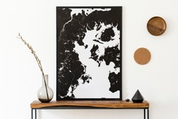 Design scandinavian interior of living room with wooden console, rings on the wall, black vases , hourglass and elegant personal accessories. Stylish mock up poster map. Modern home decor. Template.