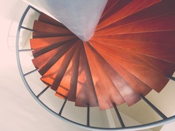 Design spiral staircase made of wood painting with red color