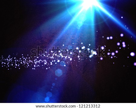 Design template - Star, sun with lens flare. Rays blue of light on a  blue background with particles