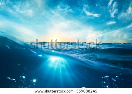 design template with underwater part and sunset skylight splitted by waterline  #359088245