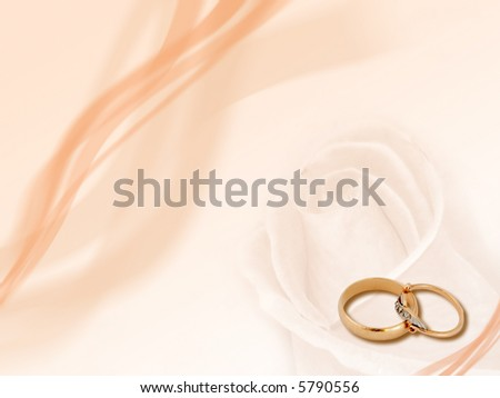 stock photo Design two wedding golden rings on smooth background