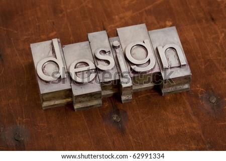 design - word in vintage metal letterpress printing blocks against grunge wooden background