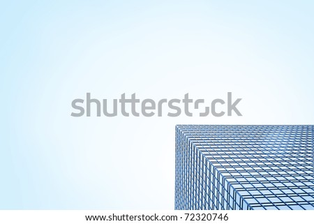 Designed business background with view of clear blue sky and modern office building corner, made of glass and steel, copy space for your text