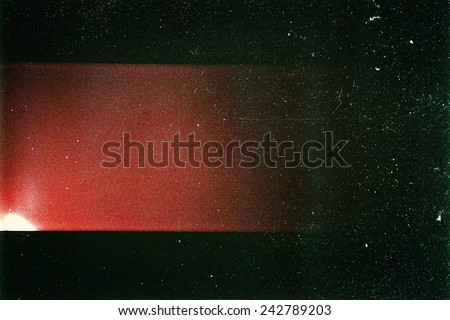 Photo of  Designed film texture background with heavy grain, dust and a light leak