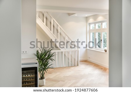 Designed in a minimalistic style staircase hall. Interior of luxury house stair hall