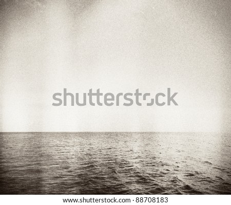 Designed retro photo. Abstract seascape. Grain, dust added as vintage effect.