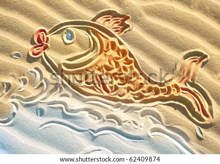Designed simple drawing on textured beach sand: a goldfish (symbol of success) jumping of sea waves