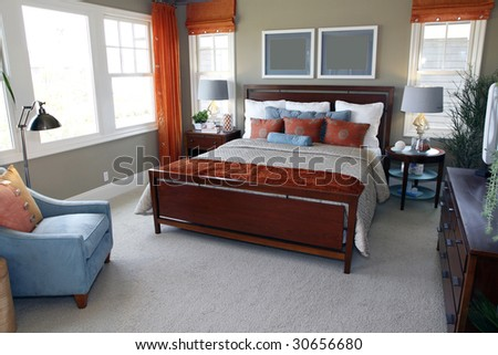 Designer bedroom with contemporary furniture and decor.