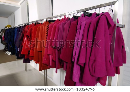 Designer clothes lined up in store