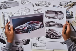 Designer engineer automotive design drawing sketch development Prototype concept car industrial creative.
