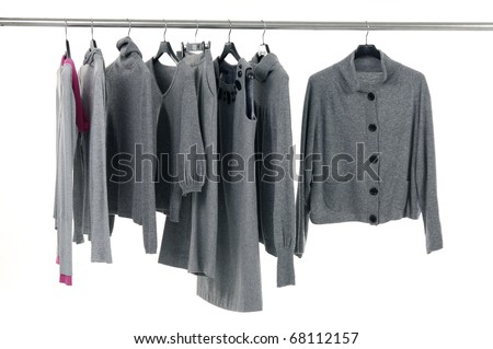 Designer fashion autumn/winter clothing on hangers - stock photo