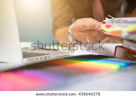 Designer hand working with laptop computer and smart phone and digital tablet on wooden desk as design concept #438646378