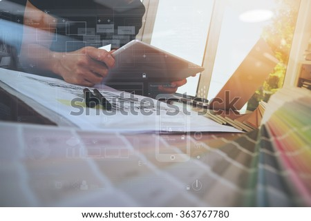 Designer hand working with laptop computer and smart phone and digital tablet with digital design diagram layer on wooden desk as responsive web design concept #363767780