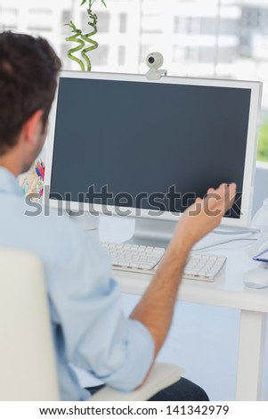 Designer having a video chat in his office on his computer
