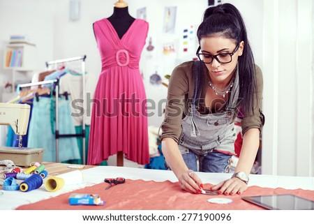 designer measuring textile...