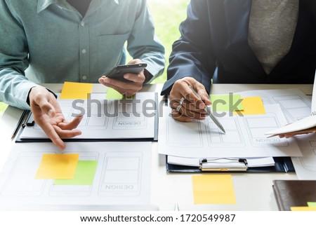 Designer men planning develop application develop for mobile phone.