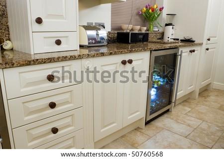Designer modern kitchen interior with granite worktop and cream units