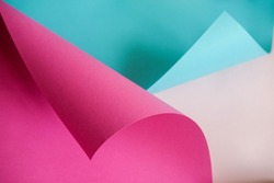 Designer paper in blue and pink. Empty space on monochrome paper.