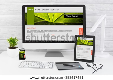 Designer's desk with responsive web ux design user experience concept.