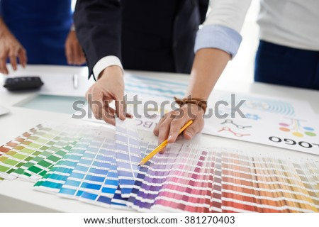 Designer searching for perfect blue color for the project #381270403
