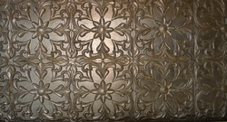 designer symmetrical fall ceiling pattern made of mud and plated with gold and silver