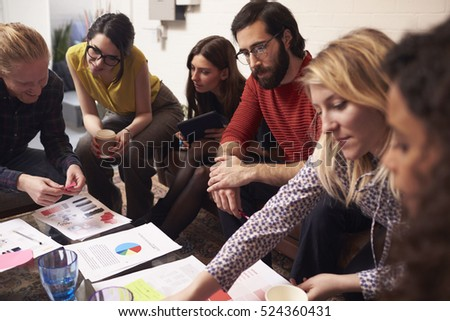 Designers Sitting On Sofa Having Creative Meeting In Office #524360431