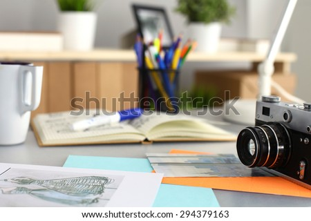 Designers table with camera and tools #294379163