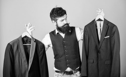 Designing made to measure suit. Custom made suit. Man bearded fashion couturier tailor. Elegant custom outfit. Tailoring and clothes design. Perfect fit. Custom made to measure. Tailored suit concept.
