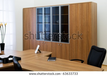 desk and leather chairs in a modern office