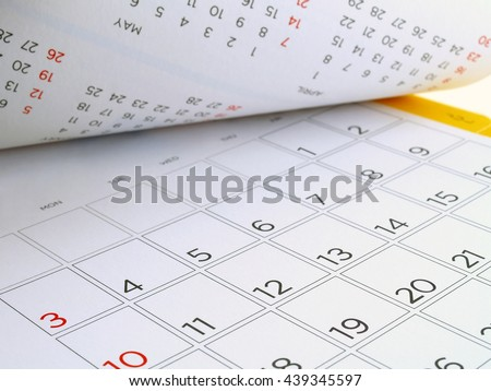 desk calendar with days and dates in July 2016, flip the calendar page #439345597
