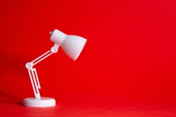 Desk lamp on red background, Idea Conceptual