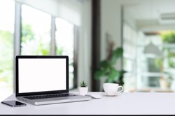 Desk Laptop with blank screen on table  blur background with bokeh background that is used for editing.