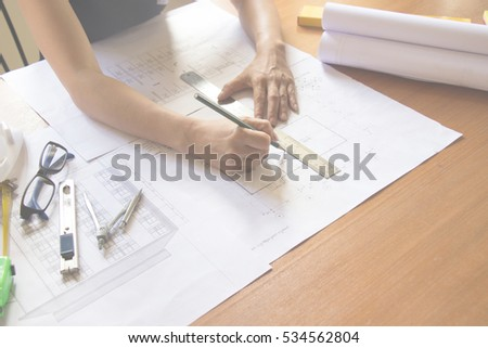 Desk of Architectural working project in construction site #534562804