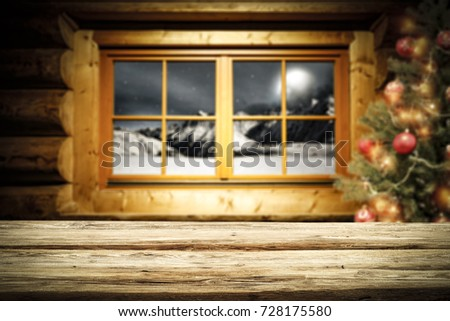 desk of free space and xmas background of window and xmas tree  #728175580