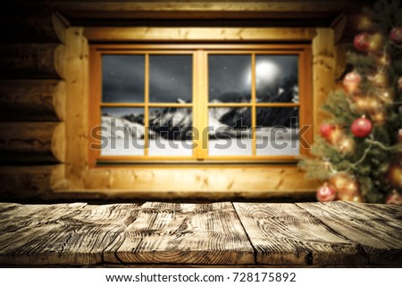 desk of free space and xmas background of window and xmas tree  #728175892