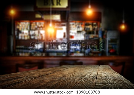 Desk of free space for your decoration and blurred background of bar.