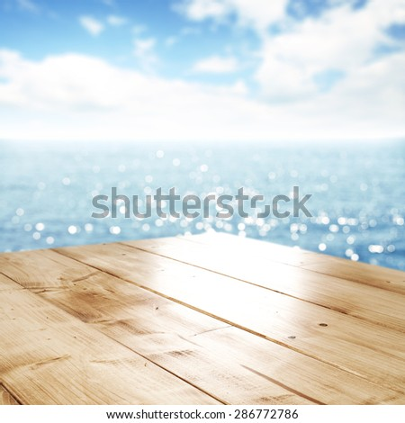 desk of yellow wood sea sky and summer day