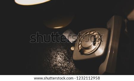 Desk, old phone, gasoline lighter and some light #1232112958